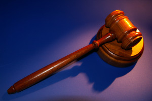 Gavel on a blue background.