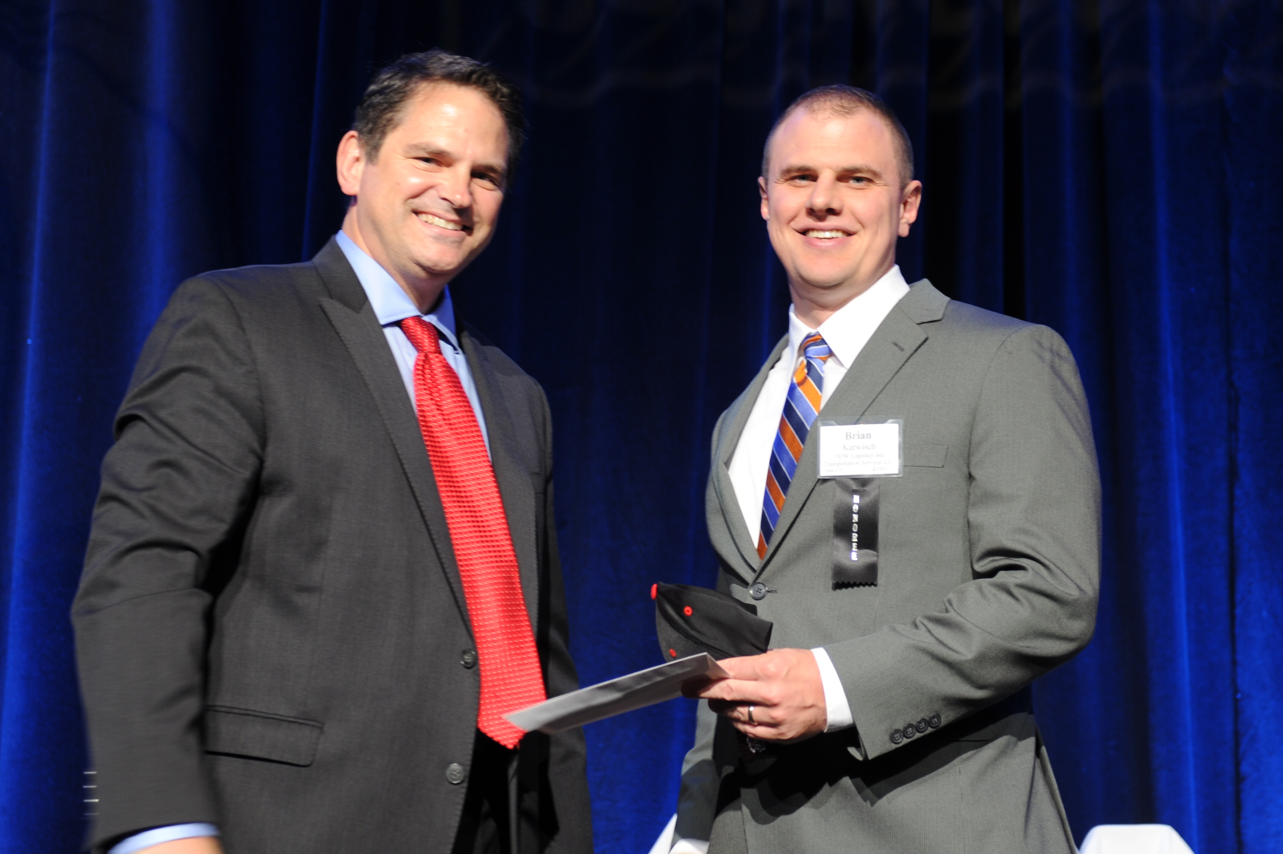 Strauss Troy President Marshall Dosker Presents MLB All Star Tickets To ODW Logistics And Transportation's Brian Karwisch At The 2015 Business Courier Fast 55 Awards presented by Strauss Troy