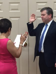 trauss Troy Shareholder Joesph Braun being sworn in as Solicitor in Loveland by Loveland Vice Mayor Angela Settell.
