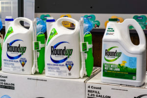 RoundUp weed killer on a store shelf; Bayer purchased Monsanto in 2018 and since then there have been more than 10,000 lawsuits filed against its subsidiary