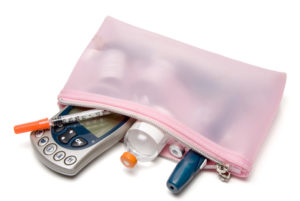 A diabetic's glucometer and diabetic testing kit.